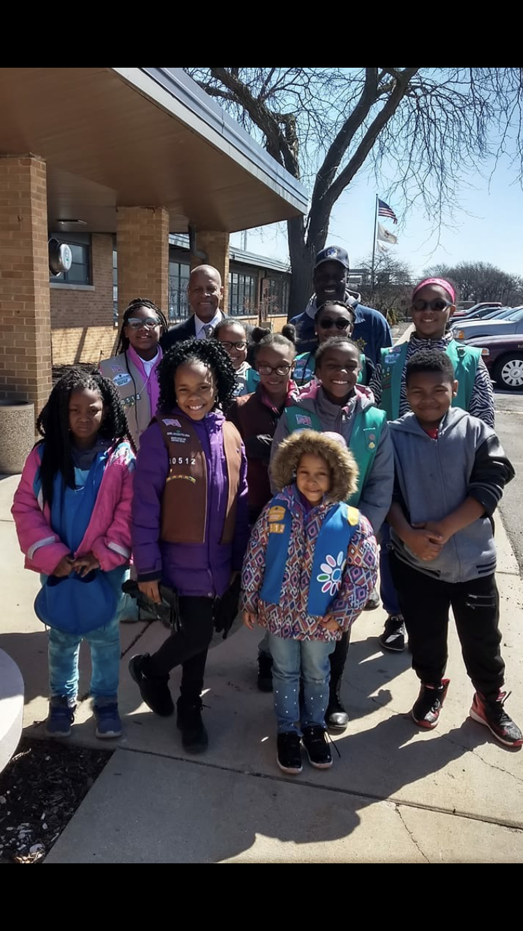 Mayor and Police Chief with members of Girl Scout Troop 60512 who volunteered for Cleanup Day.